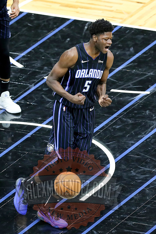 ORLANDO, FL - APRIL 07: Mo Bamba #5 of the Orlando Magic celebrates against the Washington Wizards at Amway Center on April 7, 2021 in Orlando, Florida. NOTE TO USER: User expressly acknowledges and agrees that, by downloading and or using this photograph, User is consenting to the terms and conditions of the Getty Images License Agreement. (Photo by Alex Menendez/Getty Images)*** Local Caption *** Mo Bamba