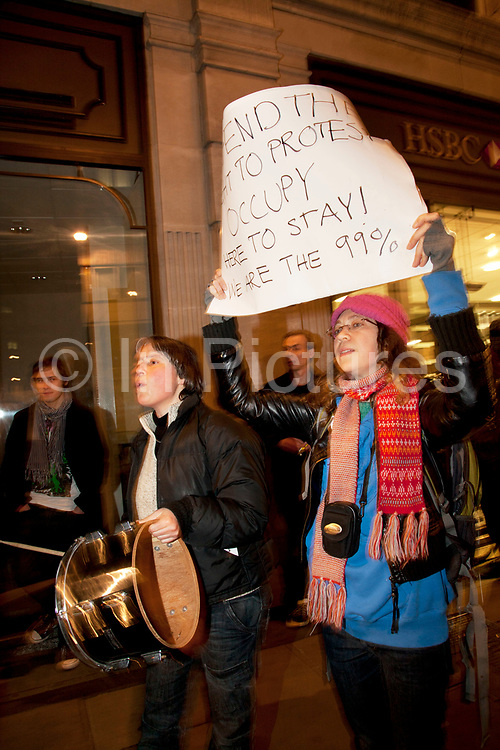 Protesters in support outside as eviction of the Occupy London OLSX camp takes place. The anti-capitalist demonstration that saw protesters camp outside St Paul's Cathedral in London was brought to an end by bailiffs and police. Protesters staging Occupy London were refused permission by the Court of Appeal last week to challenge orders evicting them from the cathedral steps, where they had been living in tents since October 15 last year. The City of London Corporation called on protesters to remove their tents voluntarily, but around 50 or 60 refused to budge. Some protesters created makeshift barriers out of wooden shelving units as police moved in to help bailiffs clear the camp. Police said 20 people had been arrested but the operation was largely peaceful.