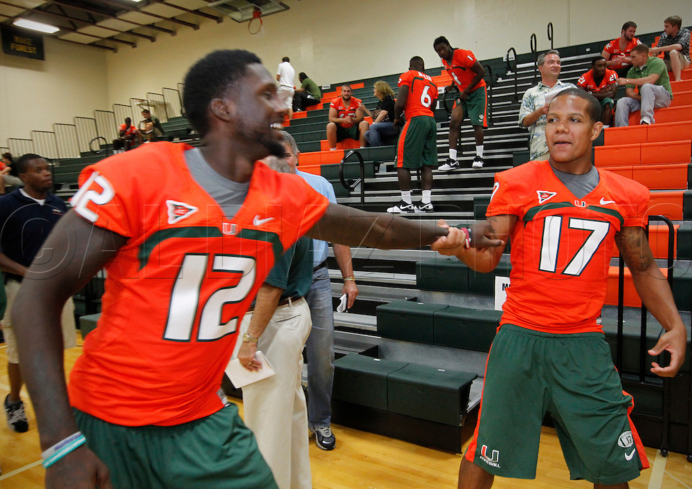 Jacory Harris and Stephen Morris goof off at the end of their media interview session during Media Day for the University of Miami Football team on Campus in Coral Gables on August 27, 2011.