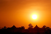 Part of Breidjing Village (at sunset) in Eastern Chad, near the border with Sudan. Very close to this village is the sprawling Breidjing refugee camp, sheltering 30,000 Sudanese who have fled the ethnic cleansing/genocide in the bordering Darfur region. (Supporting image from the project Hungry Planet: What the World Eats.)