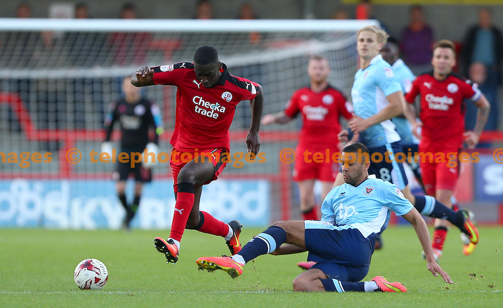 Crawley's Enzio Boldewijn evades a sliding tackle from Colin Daniel of Blackpool during the Sky Bet League 2 match between Crawley Town and Blackpool at the Checkatrade Stadium in Crawley. October 1, 2016.<br /> James Boardman / Telephoto Images<br /> +44 7967 642437