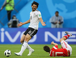 June 19, 2018 - Saint Petersburg, Russia - Ahmed Hegazy (L) of the Egypt national football team and Aleksandr Golovin of the Russia national football team vie for the ball during the 2018 FIFA World Cup match, first stage - Group A between Russia and Egypt at Saint Petersburg Stadium on June 19, 2018 in St. Petersburg, Russia. (Credit Image: © Igor Russak/NurPhoto via ZUMA Press)