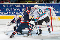 KELOWNA, CANADA - MARCH 26:  Rourke Chartier #14 of Kelowna Rockets tries to score on Connor Ingram #39 while being checked by Cameron Reagan #25 of Kamloops Blazers on March 26, 2016 at Prospera Place in Kelowna, British Columbia, Canada.  (Photo by Marissa Baecker/Shoot the Breeze)  *** Local Caption *** Cameron Reagan; Connor Ingram; Rourke Chartier;