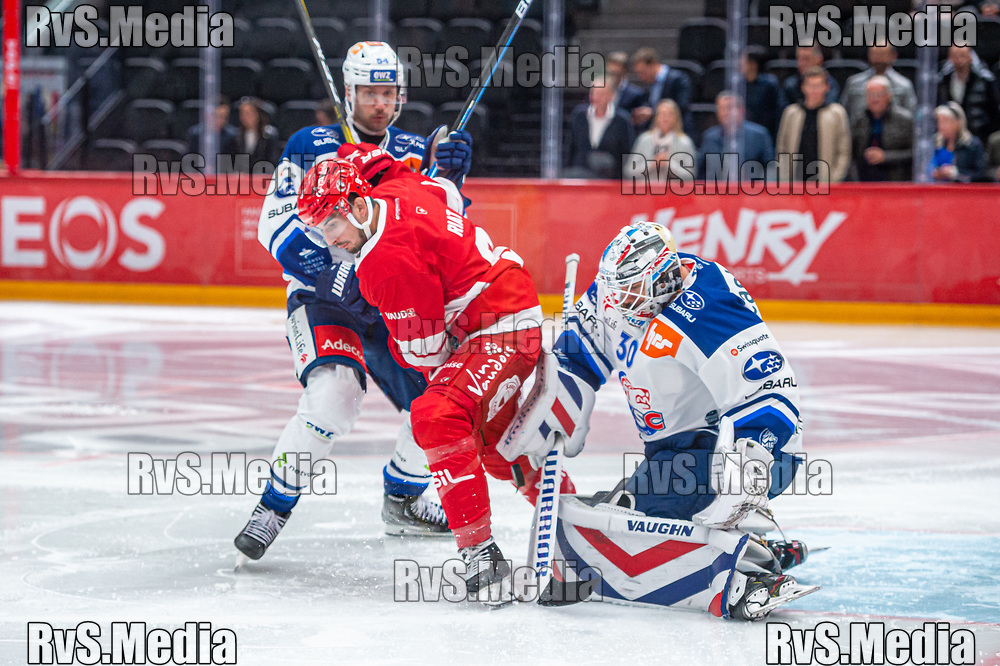 LAUSANNE, SWITZERLAND - OCTOBER 01: Goalie Lukas Flueler #30 of ZSC Lions makes a save during the Swiss National League game between Lausanne HC and ZSC Lions at Vaudoise Arena on October 1, 2021 in Lausanne, Switzerland. (Photo by Monika Majer/RvS.Media)