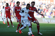 Swansea city's Jonathan de Guzman © in action. Barclays Premier league match, Swansea city v West Bromwich Albion at the Liberty Stadium in Swansea, South Wales on Saturday 15th March 2014. pic by Andrew Orchard,  Andrew Orchard sports photography.