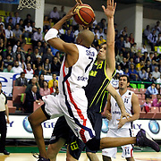 Efes Pilsen's Charles SMITH (L), Kaya PEKER (R) and Fenerbahce Ulker's Gasper VIDMAR (C) during their Turkish Basketball league Play Off Final first leg match Efes Pilsen between Fenerbahce Ulker at the Ayhan Sahenk Arena in Istanbul Turkey on Thursday 20 May 2010. Photo by Aykut AKICI/TURKPIX