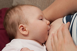 Mother breast feeding baby. (This photo has clearance for the mother to be depicted as having mental health issues including post natal depression.)