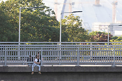 © Licensed to London News Pictures. 17/07/2020. London, UK. Police negotiators are speaking to a man who is on the ledge of a bridge that passes over the A102.  Police have blocked the A102 and have cordoned off the bridge this has caused major traffic disruption in the area.  Photo credit: George Cracknell Wright/LNP