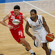 Efes Pilsen's Bootsy THORNTON (R) and Pinar Karsiyaka's Sean MARSHAL (L) during their Turkish Basketball Legague Play-Off qualifying second match Efes Pilsen between Pinar Karsiyaka at the Sinan Erdem Arena in Istanbul Turkey on Friday 13 May 2011. Photo by TURKPIX