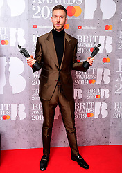 Calvin Harris with his Best British Single and Best British Producer Brit Awards in the press room at the Brit Awards 2019 at the O2 Arena, London.