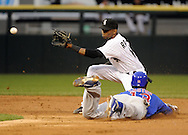 CHICAGO - JUNE 20:  Starlin Castro #13 of the Chicago Cubs steals second base as Alexei Ramirez #10 of the Chicago White Sox awaits the throw during the third inning on June 20, 2011 at U.S. Cellular Field in Chicago, Illinois.  The Cubs defeated the White Sox 6-3.  (Photo by Ron Vesely)  Subject:  Starlin Castro;Alexei Ramirez