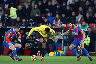 Andre Gray of Watford (c) back heels the ball under pressure from James McArthur (L) and James Tomkins of Crystal Palace (R). Premier League match, Crystal Palace v Watford at Selhurst Park in London on Tuesday 12th December 2017. pic by Steffan Bowen, Andrew Orchard sports photography.