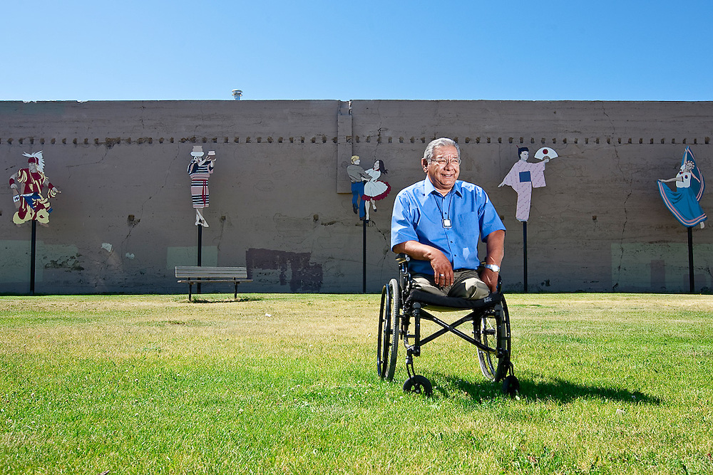 Wapato Mayor Jesse Farias poses for a portrait at Liberty Park, where public art highlights the town's diverse ethnic makeup with representations of the Native Americans, Filipinos, Japanese, Mexicans and Caucasians who live there.