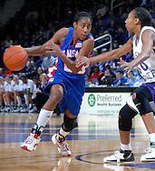 Kansas guard Sade Morris (L) drives against pressure from Kansas State's Shana Wheeler (R) in the first half at Bramlage Coliseum in Manhattan, Kansas, January 24, 2007.  K-State beat Kansas 59-55.