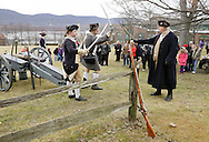 Newburgh, New York - Revolutionary War reenactors in uniforms drill with swords at Washington's Headquarters State Historic Site as part of George Washington's birthday celebration on Feb. 18, 2012. The reenactors are from John Lamb's Artillery Company. The Hudson River is visible in the background.
