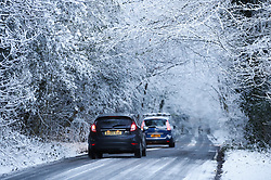 © Licensed to London News Pictures. 30/01/2019. Sevenoaks, UK. Cars travel on an icy road near Sevenoaks as snow hits the south east for the first time this winter. Photo credit: Peter Macdiarmid/LNP