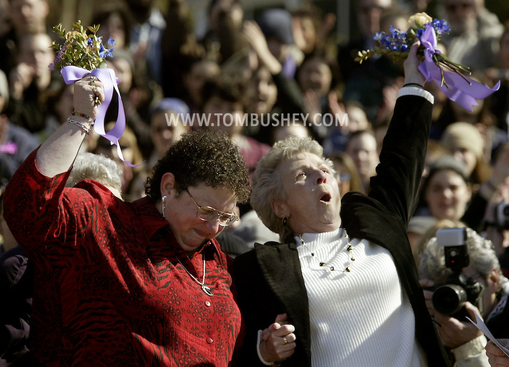 Joanne Still, left, and Mary Mendola celebrate their marriage in New Paltz.  New Paltz Mayor Jason West officiated  at the weddings of 21 gay couples in Peace Park..tbthr GAY WEDDING
