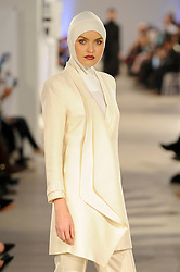 © Licensed to London News Pictures. 19/02/2017. London, UK.  A model shows a look by Blancheur (Malaysia) on the final day of the UK's first London Modest Fashion Week taking place this weekend at the Saatchi Gallery.  The two day event sees 40 brands from across the world come together to showcase their collections for Muslim and other religious women. Photo credit : Stephen Chung/LNP