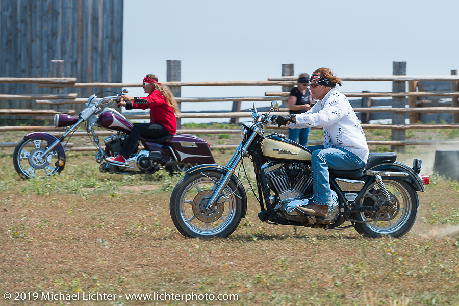 Bean're  (back) riding one on one against Jay Allen (foreground) at the Spur Creek Ranch north of Sturgis during a stop for food and cowboy games on the annual Michael Lichter - Sugar Bear Ride hosted by Jay Allen from the Easyriders Saloon during the Sturgis Black Hills Motorcycle Rally. SD, USA. Sunday, August 3, 2014. Photography ©2014 Michael Lichter.