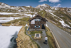 THEMENBILD - ein Mann vor dem Haus Bau der Strasse. Die Hochalpenstrasse verbindet die beiden Bundeslaender Salzburg und Kaernten und ist als Erlebnisstrasse vorrangig von touristischer Bedeutung, aufgenommen am 27. Mai 2020 in Fusch a.d. Glstr., Österreich // a man in front of the house building the road. The High Alpine Road connects the two provinces of Salzburg and Carinthia and is as an adventure road priority of tourist interest, Fusch a.d. Glstr., Austria on 2020/05/27. EXPA Pictures © 2020, PhotoCredit: EXPA/ JFK