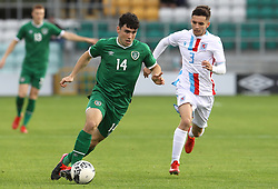 Republic of Ireland's Liam Kerrigan (left) and Luxembourg's Alexandre Sacras battle for the ball during the UEFA Under-21 Championship Qualifying Round Group F match at the Tallaght Stadium, Dublin. Picture date: Friday October 8, 2021.