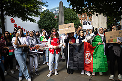 © Licensed to London News Pictures. 28/08/2021. Manchester, UK. A demonstration against the Taliban's takeover of Afghanistan is held in front of the Cenotaph in St Peter's Square in Manchester City Centre . Photo credit: Joel Goodman/LNP