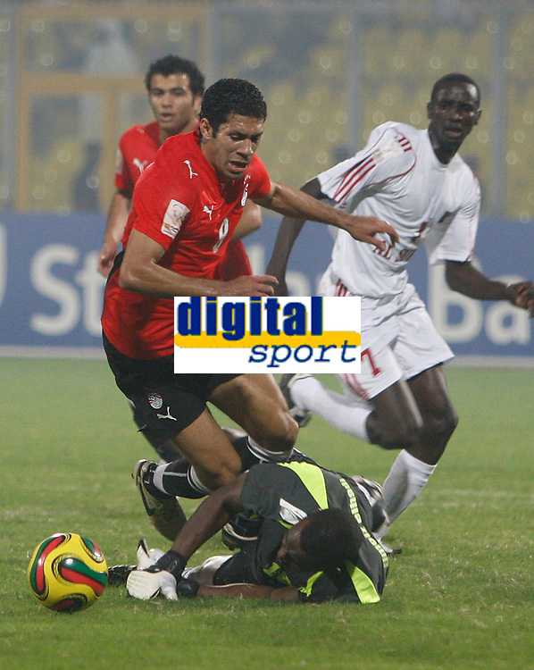 Photo: Steve Bond/Richard Lane Photography.<br /> Egypt v Sudan. Africa Cup of Nations. 26/01/2008. Mohamed Zidan (L) is brought down by keeper Elmuez Mahgoub for a penalty