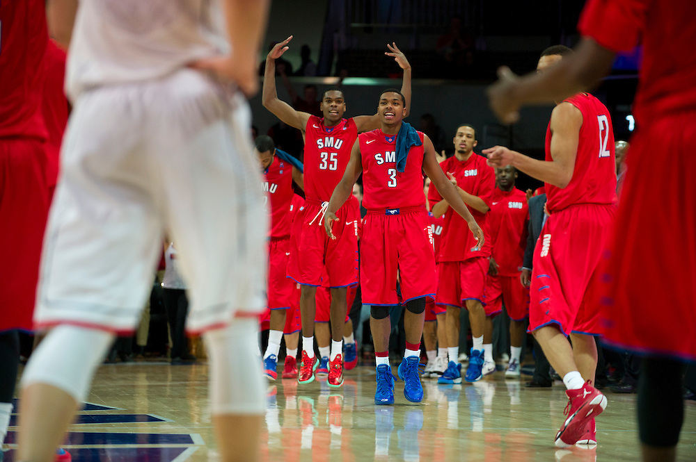 DALLAS, TX - JANUARY 4: Sterling Brown #3 and the SMU Mustangs celebrate with teammates after securing the lead late in the second half against the Connecticut Huskies on January 4, 2014 at Moody Coliseum in Dallas, Texas.  (Photo by Cooper Neill) *** Local Caption *** Sterling Brown