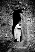 Ethiopian Orthodox pilgrims at Lalibela, Ethiopia. A Hermit by the cave that is home. Lalibela in northern Ethiopia is famous for it's monolithic roack hewn churches and is one Ethiopia's holiest cities and a centre of pilgrimage for much of the country.