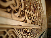 Arabic engravings along the walls of Palacios Nazaries in the Alhambra, Granada (Andalusia), Spain.