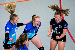 Team Zwolle celebrate with Iris Reinders of Zwolle, Daantje Vennik of Zwolle, Kim de Wild of Zwolle before the first league match between Djopzz Regio Zwolle Volleybal - Laudame Financials VCN on February 27, 2021 in Zwolle.