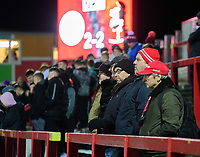Lincoln City fans watch their team in action<br /> <br /> Photographer Andrew Vaughan/CameraSport<br /> <br /> The EFL Checkatrade Trophy Second Round - Accrington Stanley v Lincoln City - Crown Ground - Accrington<br />  <br /> World Copyright © 2018 CameraSport. All rights reserved. 43 Linden Ave. Countesthorpe. Leicester. England. LE8 5PG - Tel: +44 (0) 116 277 4147 - admin@camerasport.com - www.camerasport.com