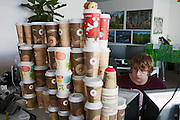 Moscow, Russia, 26/03/2012..Work station cluttered with empty coffee cups inside the Silicon Valley style headquarters of Russian internet search company Yandex.