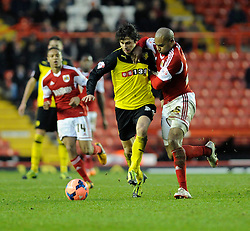 Bristol City's Marvin Elliott jostles for the ball with Watford's Diego Fabbrini - Photo mandatory by-line: Dougie Allward/JMP - Tel: Mobile: 07966 386802 04/01/2014 - SPORT - FOOTBALL - Ashton Gate - Bristol - Bristol City v Watford - FA Cup - Third Round