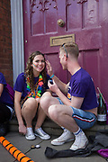 Face painting during the Manchester Pride Parade on the 25th August 2018 in Manchester in the United Kingdom. The Manchester Pride is an annual LGBT pride festival and parade held each summer in the city of Manchester, England.