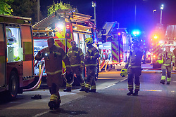 © Licensed to London News Pictures. 09/10/2021. Stokenchurch, UK. Firefighters battle a huge blaze at the Kings Hotel in Stokenchurch, Buckinghamshire. The fire started late on Friday evening (08/10/2021) with firefighters being called in from Buckinghamshire, Berkshire and Oxfordshire Fire Rescue Services. Photo credit: Peter Manning/LNP