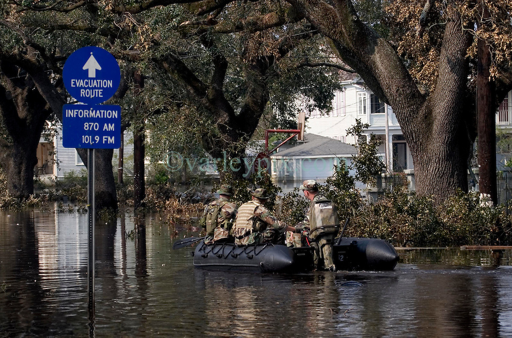 05 Sept  2005. New Orleans, Louisiana. Post hurricane Katrina.<br /> The US military patrol the streets in Uptown New Orleans on Napolean Ave in boats as they look for survivors to evacuate.<br /> Photo; ©Charlie Varley/varleypix.com