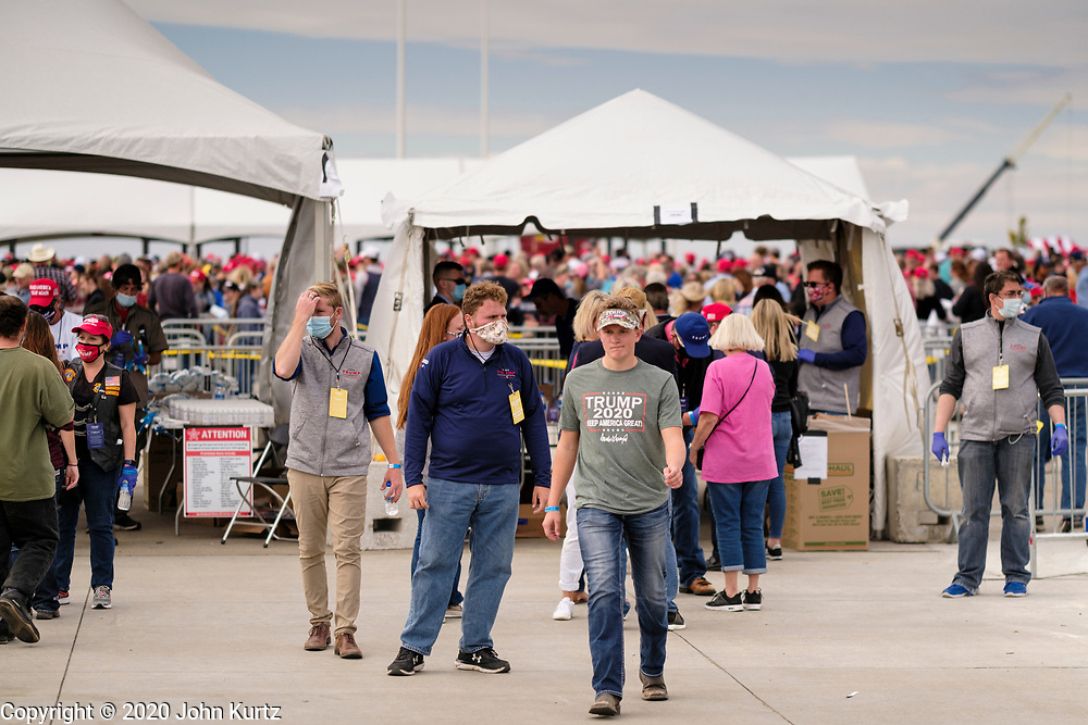 14 OCTOBER 2020 - DES MOINES, IOWA: About10,000 people were expected at the Des Moines International Airport for a campaign rally supporting the reelection of President Donald Trump. Trump spoke at the rally, despite testing positive for COVID-19 less than three weeks ago. The rally did not meet the CDC guidelines for a safe gathering in the time of Coronavirus and violated Iowa's health emergency declarations barring gatherings of more than 25 people. This Iowa exceeded 101,000 cases of COVID-19 and a surge in hospitalizations for COVID-19.        PHOTO BY JACK KURTZ