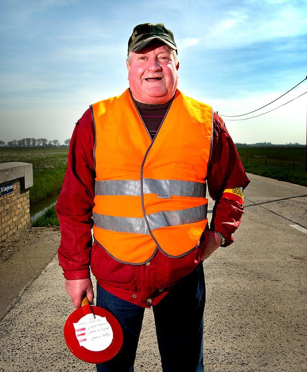 Belgie, Vlaanderen, Westhoek, 02-04-2014.<br /> Wielrennen, Elite Mannen, 3-daagse van de Panne.<br /> Signaalgevers bij de wielerkoers 3-Daagse van de Panne.<br /> <br /> Naam : Jean Pierre van Alma, 30 jaar actief als signaalgever.<br /> <br /> Foto: Klaas Jan van der Weij