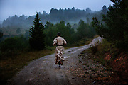 Augusine monk still wearing his white habit jogging at dawn in the countryside close to the Abbey of Lagrasse, Corbier.