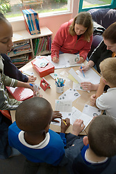 Group of children working on school project in classroom,