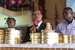 3 November 2019, Monrovia, Liberia: Rev. Samuel B. Reeves Jr invites Holy Communion during Sunday service at the Providence Baptist Church, also known as 'the cornerstone of the nation', as it was in the Providence Baptist Church that Liberia's declaration of independence was signed. While this Sunday service is taking place in a larger worship space finalized in 1976, the old chapel remains in place adjacent to the new one, and is still in use.