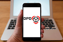Using iPhone smartphone to display logo of DPD international parcel delivery company