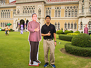 10 JANUARY 2015 - BANGKOK, THAILAND:  A man poses with a life sized cardboard cutout of General Prayuth Chan-ocha, the Prime Minister of Thailand, during Children's Day festivities at Government House. Prayuth commanded a coup that deposed the elected government in May 2014. National Children's Day falls on the second Saturday of the year. Thai government agencies sponsor child friendly events and the military usually opens army bases to children, who come to play on tanks and artillery pieces. This year Thai Prime Minister General Prayuth Chan-ocha, hosted several events at Government House, the Prime Minister's office.   PHOTO BY JACK KURTZ