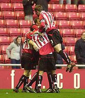 Photo. Glyn Thomas.<br /> Sunderland v Burnley. Nationwide Division 1.<br /> Stadium of Light, Sunderland. 29/11/03.<br /> Sunderland's Kevin Kyle is mobbed by teammates after scoring his side's first goal.