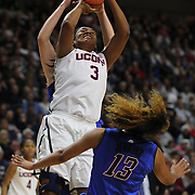 Morgan Tuck, UConn, fouls Chanise Jenkins, DePaul, as she drives to the basket during the UConn Vs DePaul, NCAA Women's College basketball game at Webster Bank Arena, Bridgeport, Connecticut, USA. 19th December 2014