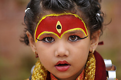 September 4, 2017 - Kathmandu, Nepal - A young Nepalese girl impersonating a Kumari or living Goddess as she participates during a celebration of Kumari Puja at Basantapur Durbar Square, Kathmandu, Nepal. Altogether,108 young girls under the age of nine gathered for the Kumari Puja, a tradition of worshiping, which they believe saves young girls from diseases and bad luck in future. (Credit Image: © Narayan Maharjan/NurPhoto via ZUMA Press)