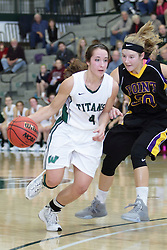 12 December 2015:  Rebekah Ehresman passes the three point line and Lauren Anklam during an NCAA women's basketball game between the Wisconsin Stevens Point Pointers and the Illinois Wesleyan Titans in Shirk Center, Bloomington IL