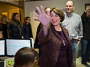28 NOVEMBER 2019 - DES MOINES, IOWA: US Senator AMY KLOBUCHAR (D-MN) waves to people at the South Des Moines Community Center when she arrived at the center to serve Thanksgiving lunches. Sen. Klobuchar is campaigning to be the Democratic nominee for the US Presidency. Iowa holds the first selection event of the Presidential election cycle. The Iowa caucuses are Feb. 3, 2020.             PHOTO BY JACK KURTZ