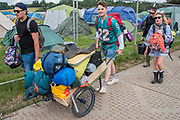 It is Sunday morning and the packing and preparing to leave has already started - The 2017 Glastonbury Festival, Worthy Farm. Glastonbury, 25 June 2017